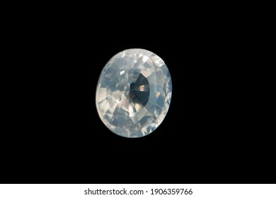 White zircon bead isolated on black background