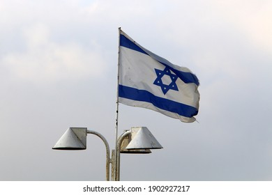The white-blue flag of the State of Israel.
