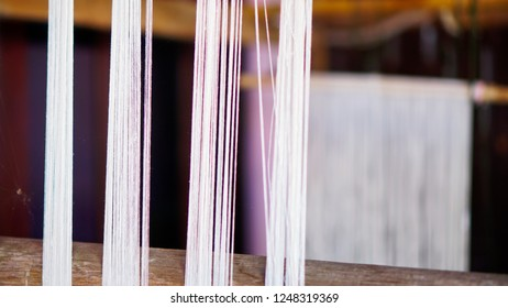 White-brown thread of traditional weaving, abstract background