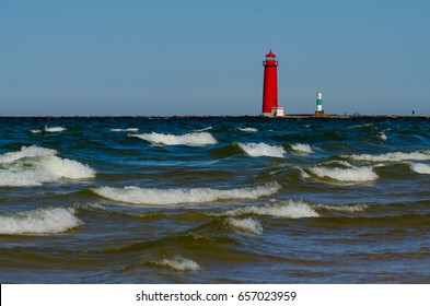 White-capped waves roll past the lighthouse in Grand Haven, Michigan