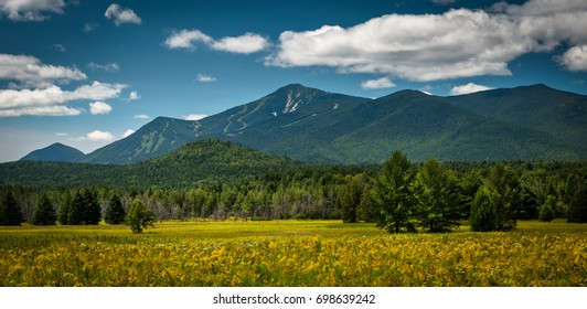Whiteface Mountain on a sunny summer afternoon looking west from Wilmington, New York. The carve-outs for the ski trails can be seen from this direction.