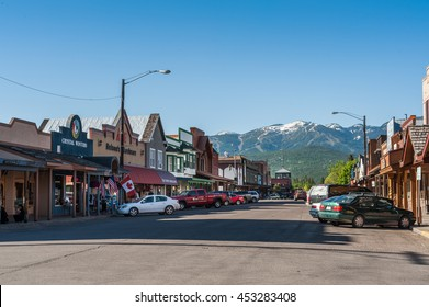 Whitefish, Montana, USA - May 29, 2009 : view of the main street of Whitefish city with houses, stores, cars