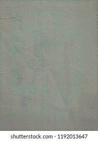 White-gray with green plastered surface, painted. Wall with weathered areas of peeling paint with small cracks little contrast perfectly as background for illustration space for text