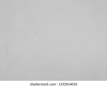 White-gray plastered surface, painted. Wall with weathered areas of peeling paint with small cracks little contrast perfectly as background for illustration space for text