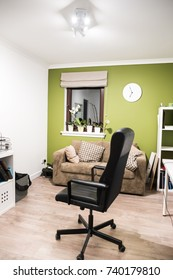 White/green office space and black chair