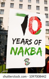 Whitehall, London. 15th May 2018. EDITORIAL - 70 years of NAKBA placard at the Gaza: Stop The Massacre rally in Whitehall, London, in protest of Palestinian civilians killed by Israeli military.