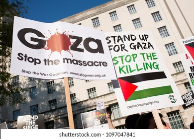 Whitehall, London. 15th May 2018. EDITORIAL - Low angle view of placards at the Gaza: Stop The Massacre rally in Whitehall, London, in protest of Palestinian civilians killed by Israeli military.
