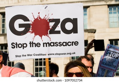 Whitehall, London. 15th May 2018. EDITORIAL - Protester with placard at the Gaza: Stop The Massacre rally in Whitehall, London, in protest of Palestinian civilians killed by Israeli military.