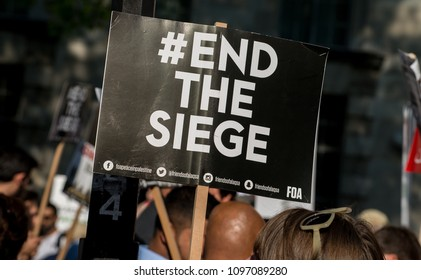 Whitehall, London. 15th May 2018. EDITORIAL - End The Siege placard at the Gaza: Stop The Massacre rally in Whitehall, London, in protest of Palestinian civilians killed by Israeli military.