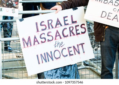 Whitehall, London. 15th May 2018. EDITORIAL - Anti war /Israel placard at the Gaza: Stop The Massacre rally in Whitehall, London, in protest of Palestinian civilians killed by Israeli military.