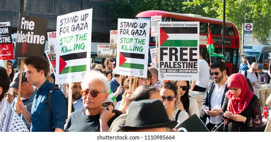 Whitehall, London. 15th May 2018. EDITORIAL - Protesters with placards at the Gaza: Stop The Massacre rally in Whitehall, London, in protest of Palestinian civilians killed by Israeli military.