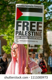 Whitehall, London. 15th May 2018.  - Protester with placard at the Gaza: Stop The Massacre rally in Whitehall, London, in protest of Palestinian civilians killed by Israeli military.