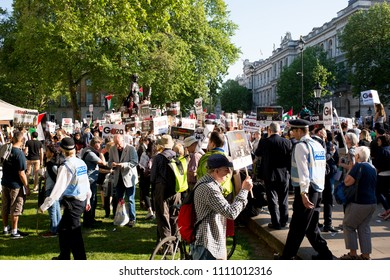 Whitehall, London. 15th May 2018. EDITORIAL. Hundreds of protesters gather at the Gaza: Stop The Massacre rally in Whitehall, London, in protest of Palestinian civilians killed by Israeli military.