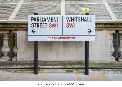 Whitehall, London - 5 June 2017 - SW1 street sign pointing to Parliament Street (left) or Whitehall (right).