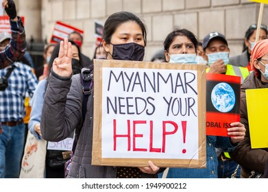 WHITEHALL, LONDON, ENGLAND- 31 March 2021: Protesters marching towards the Chinese Embassy at a protest against Myanmar's military coup