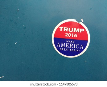 "Whitehall, Pennsylvania / USA - May 06 2017: Adhered to a newspaper vending machine is this sticker supporting Donald Trump and his campaign to ""Make America Great Again!"""