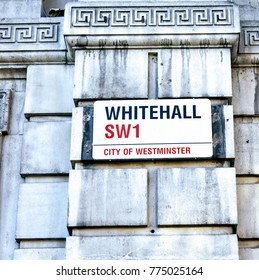 Whitehall SW1 Street sign on a government building in the City of Westminster, London, December 2017.