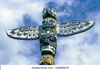 WHITEHORSE, CANADA - JULY 1:  Indian totem pole in Whitehorse city in Yukon Territory on July 1, 1997. Totem poles are monumental sculptures of the indigenous peoples of the Pacific Northwest