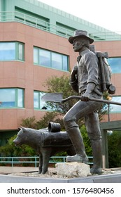 Whitehorse, Yukon / Canada - August 16 2019: The Prospector Statue in Whitehorse, the Yukon, Canada. The sculpture on Main Street depicts a Gold Rush era prospector and his dog.