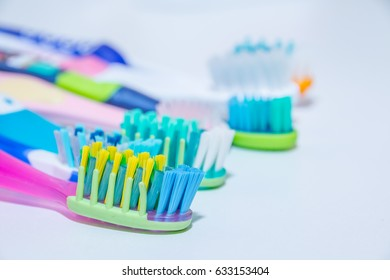 whitening. tooth care. teeth healthy concept. New ultra soft  toothbrushes in a row,  Dental Industry. various types of toothbrushes. beautiful smile concept.