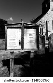 Whiteparish, Wiltshire, England - July 31, 2018: monochrome Notice board at All Saints parish church in the Church of England diocese of Salisbury, building dating back to circa 1190
