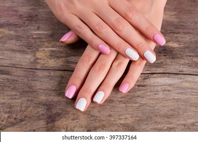 White-pink manicure on old retro background. Salon of nail aesthetics.