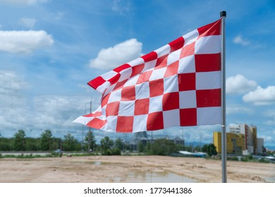 The white-red chess flag on the racetrack.