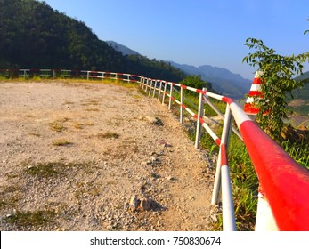 The White-red fence at the high point.