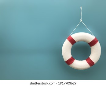 A white-red lifebuoy hanging on blue background and space for text. Rescue equipment. Safety concept