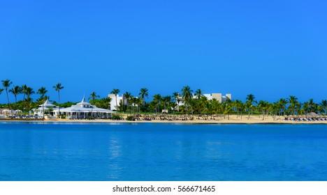 white-sand beach Dominican Republic Caribbean sun on blue sky