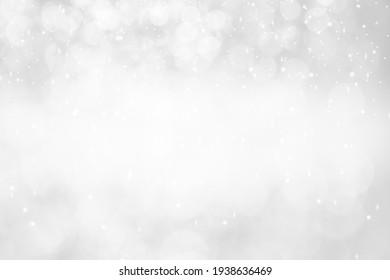 White,Silver glitter vintage lights background defocused for festivals and celebrations.