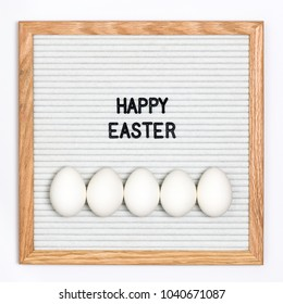 White-themed Easter. Letter board with Easter eggs saying Happy Easter.