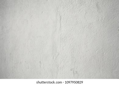 Whitewahed wall with uneven texture as a architectural background.