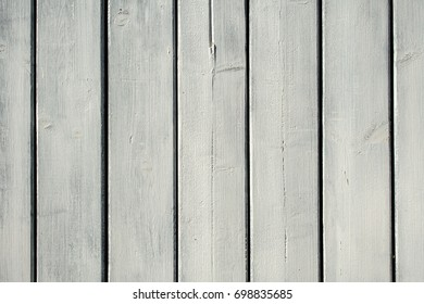 Whitewash wood panels with distressed look.