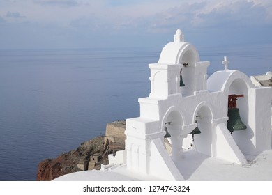 Whitewashed bell tower of Greek church in Oia on Santorini, Greece