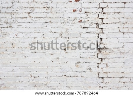 vertical crack on brick wall