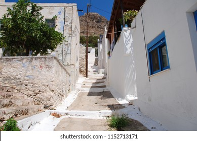 The whitewashed buildings of Megalo Chorio on the Greek island of Tilos. The village is the capital of the island which has a population of around 780 people.