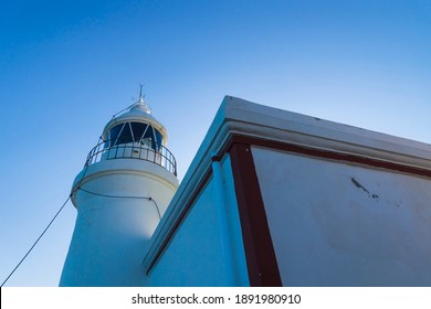 Whitewashed lighthouse keeping a smal museum in the natural park Serra Gelada in Albir, Costa Blanca, Spain