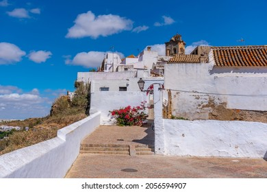 Whitewashed street of the old town of Arcos de la Frontera, one of pueblos blancos, in Spain