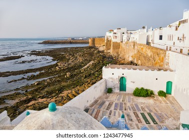 Whitewashed waterfront buildings in Asilah, Morocco.