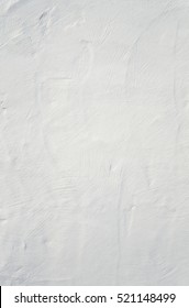 Whitewashed white painted textured wall background.