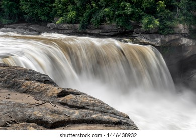 Whitewater courses over Cumberland Falls, a large waterfall in southeastern Kentucky.