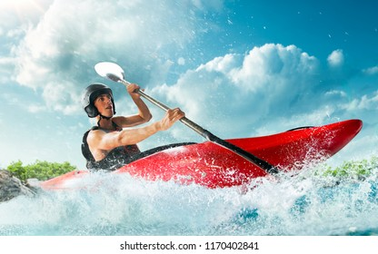 Whitewater kayaking, extreme kayaking. A guy in a kayak sails on a mountain river
