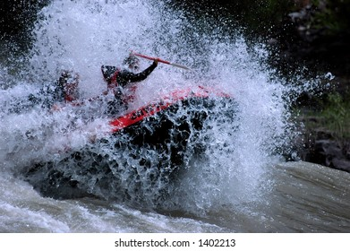 whitewater raft exploding through river wave