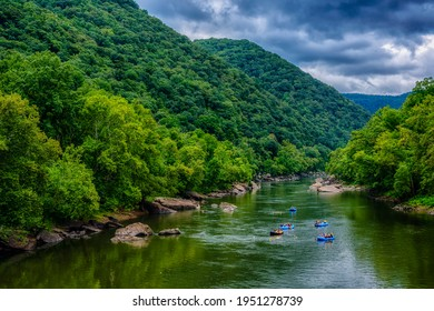 Whitewater rafts float down the river,  New River Gorge National Park and Preserve, Fayette County, West Virginia, USA, August 18, 2017