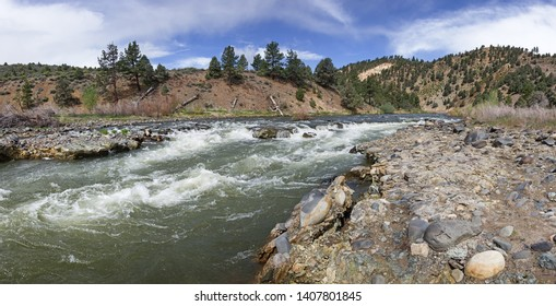 whitewater rapid over conglomerate ledge rocks on the East Fork of the Carson River