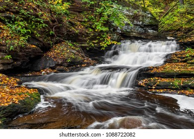 Whitewater splashes down a cascading waterfall in Ganoga Glen at Ricketts Glen State Park, Pennsylvania.