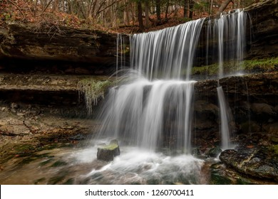 Whitewater splashes down tow tiers of ledges at the waterfall in beautiful Oglebay Park in Wheeling, West Virginia.