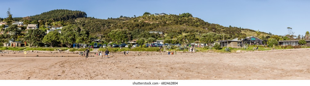 Whitianga, New Zealand - June 04, 2017:  People enjoying the sunny day at Hot Water beach, geothermal attractions in Coromandel, New Zealand.