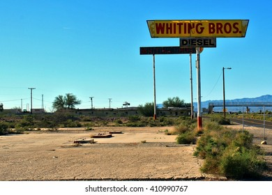 Whiting Bros. Diesel sign above removed gas pumps. March 9, 2016. Yucca, AZ.